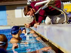 Collaborate with professional Spanish trainers on swimming camp in Barcelonas